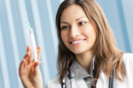 Happy female doctor with syringe at office Stock Photo - 7582355