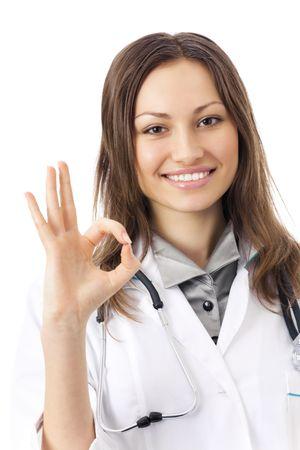 stimme: Gl�cklich female Doctor mit okay Geste, isolated on white  Lizenzfreie Bilder