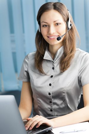 Support phone operator in headset at workplace Stock Photo - 7620148