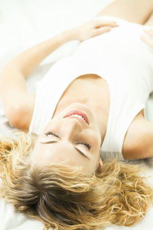 Young sleeping woman at bedroom photo