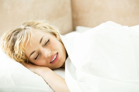 Young sleeping woman at bedroom photo