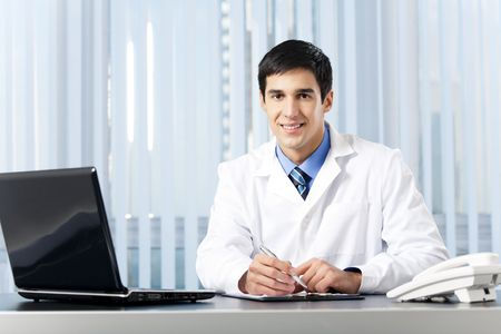 Successful doctor with laptop, at office photo