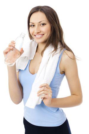 ejercicio aer�bico: Mujer en el agua potable de ropa deportiva, aislado en blanco  Foto de archivo