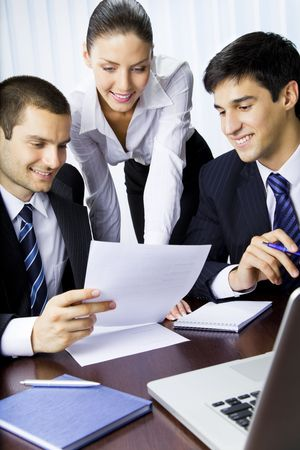 Three businesspeople working with document at office Stock Photo - 7717675