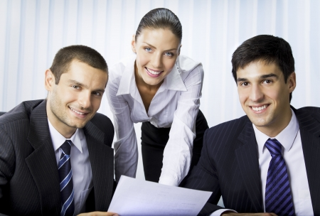 Three businesspeople working with document at office Stock Photo - 7717679