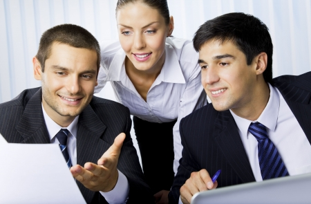 Three businesspeople working with document at office  Stock Photo - 7717674