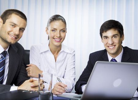 Portrait of three businesspeople at office photo