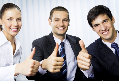 Happy successful gesturing businesspeople at office Stock Photo - 7778474