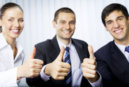 Happy successful gesturing businesspeople at office. Focus on hands. photo
