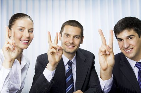 Happy successful gesturing businesspeople at office photo