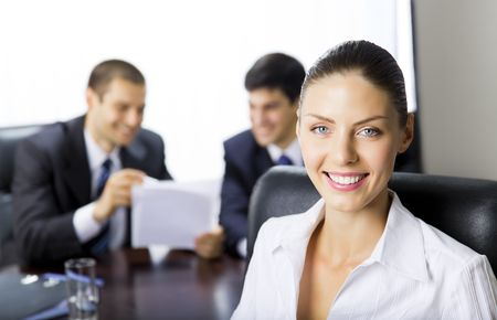 Portrait of successful businesswoman and colleagues on background, at office Stock Photo - 7778479