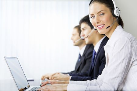 client service: Three support phone operators at workplace