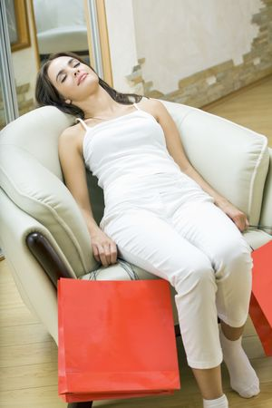 Young woman with shopping bags, indoors photo