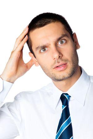 Puzzled businessman, isolated on white photo