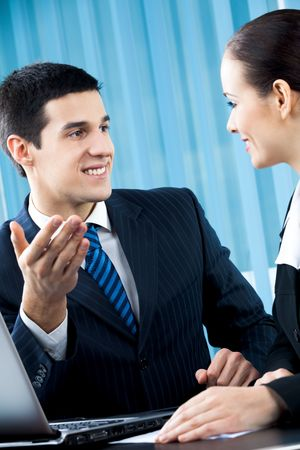 Two happy businesspeople at office Stock Photo - 7875246