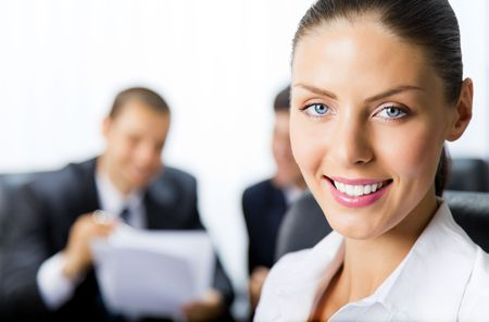 Portrait of successful businesswoman and colleagues on background, at office Stock Photo - 7875265