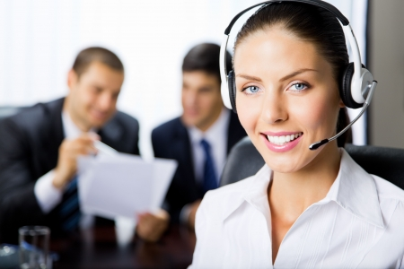 handsfree phone: Portrait female support phone operator at workplace Stock Photo