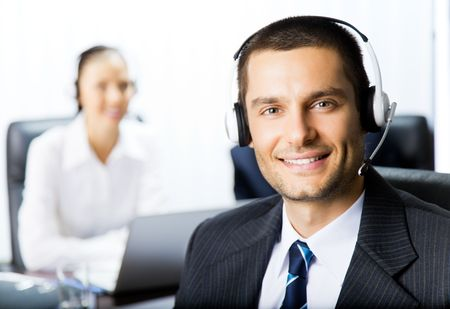 Two support phone operators at workplace photo