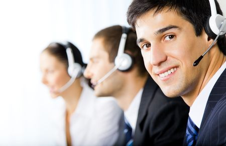 support services: Three support phone operators at workplace