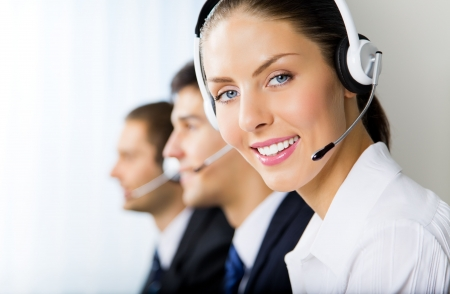 Three support phone operators at workplace photo
