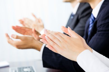 Close up clapping hands of businesspeople at presentation, meeting, seminar or conference Stock Photo - 7875256