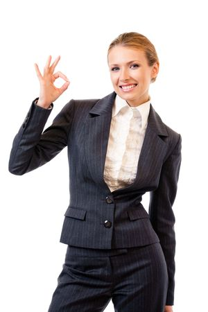 Businesswoman with okay gesture, isolated on white photo