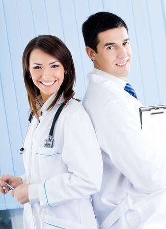 Portrait of two medical people at office photo