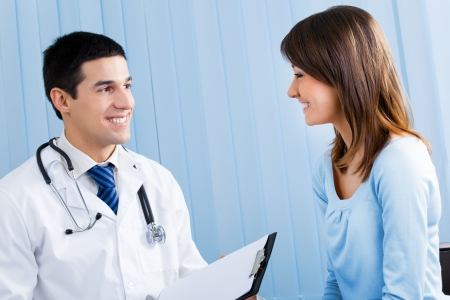 doctor visit: Doctor and patient with prescription at office Stock Photo