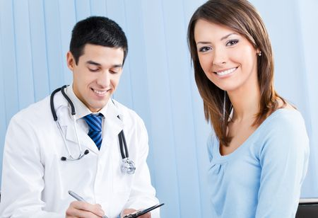doctor exam: Happy female patient and doctor at office