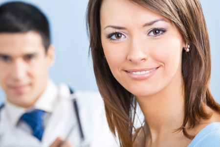 Happy female patient and doctor at office. Focus on woman. Stock Photo - 8001822