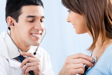Doctor with stethoscope and female patient Stock Photo - 8001827