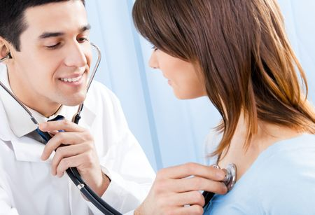 Doctor with stethoscope and female patient photo