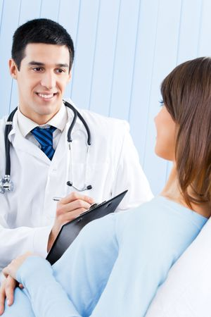 Doctor and patient with prescription at office photo
