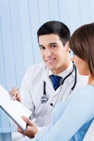 Doctor and patient with prescription at office Stock Photo - 8001820