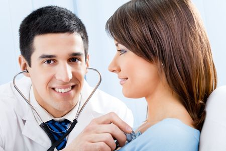 Doctor with stethoscope and female patient Stock Photo - 8001832