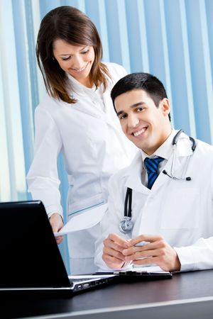 Two medical people working at office Stock Photo - 8001789