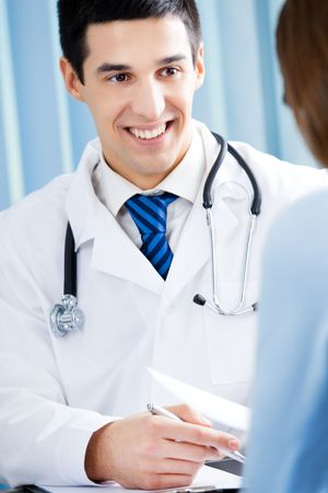 Doctor and patient with prescription at office Stock Photo