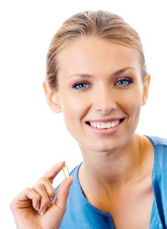 pills in hand: Mujer con c�psula de aceite de pescado de Omega 3, aislado en blanco  Foto de archivo