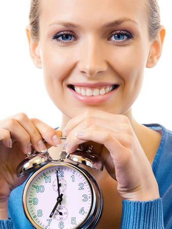 Young woman with alarmclock, isolated on white photo