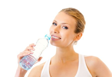 Woman in sportswear drinking water, isolated on white photo