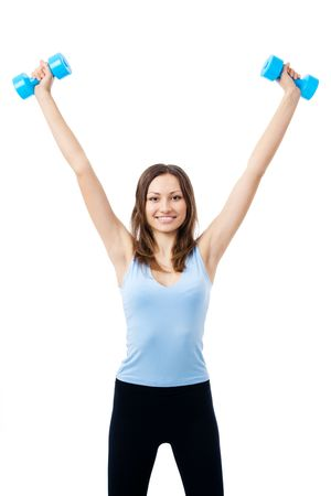 Young happy smiling woman in sportswear, doing fitness exercise with dumbbells, isolated on white background photo