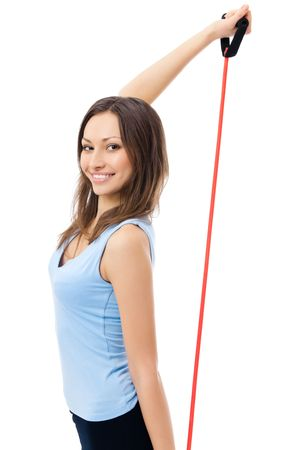 espander: Portrait of young happy smiling woman in sportswear with fitness expander, isolated on white background
