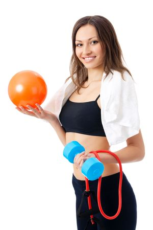 Portrait of young happy smiling woman in sportswear with dumbbell, fitness ball and expander, isolated on white background