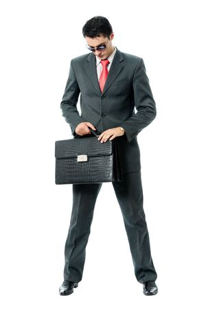 malefactor: Businessman or hacker in sun glasses with briefcase, isolated on white background