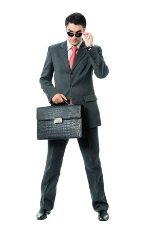 unlawful: Businessman or hacker in sun glasses with briefcase, isolated on white background