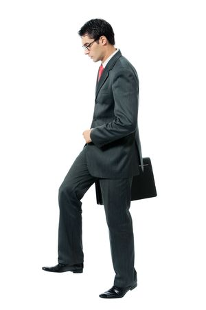 important people: Walking businessman with briefcase, isolated on white background Stock Photo