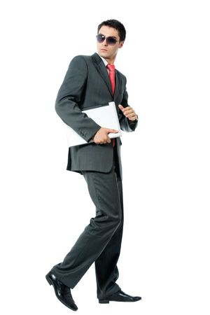 Businessman or hacker in sun glasses with laptop running, isolated on white background photo
