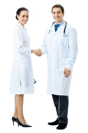 shaking out: Full body portrait of two medical people handshaking, isolated on white background Stock Photo