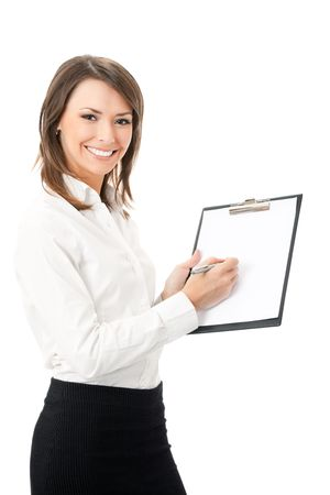 Happy smiling cheerful young businesswoman writing on clipboard, isolated on white background photo