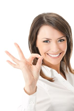 Portrait of happy smiling businesswoman with okay gesture, isolated on white background photo